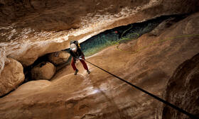 Kathleen Wendt rappels down to the narrow lower chamber in Devils Hole 2 cave.