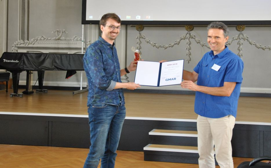 Matthias Hirschmanner wins the Best Student Poster Award sponsored by the GMAR-Robotics